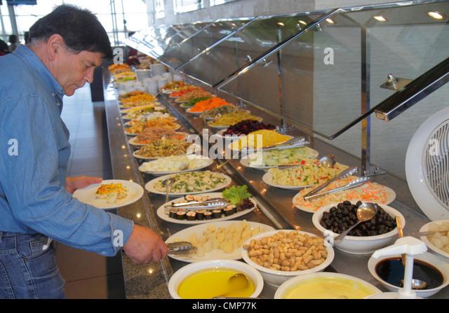 Santiago Chile Comodoro Arturo Merino Benítez International Airport SCL Hispanic man restaurant food safety - Stock Image