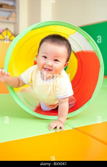 Baby Boy Playing - Stock Image
