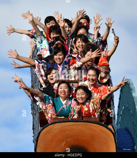 Tokyo, Japan. 9th Jan, 2017. Despite the freezing rain, young Japanese women gussy themselves up with fine long - Stock Image
