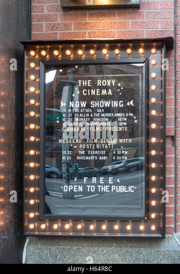A sign outside the Roxy Hotel in Tribeca shows the schedule for their free movies - Stock Image
