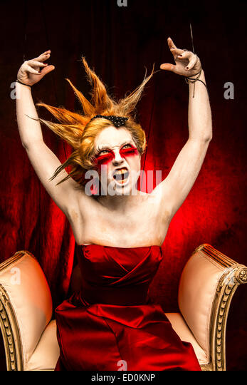 Fantasy makeover photography - Seven Deadly Sins - Wrath : A young woman girl model with spiky punky hair made up - Stock Image