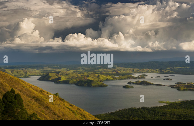 Dramatic clouds over lake Sentani, West Papua, Indonesia - Stock Image