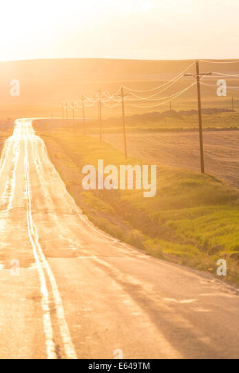 Open road at sunset, Montana, USA - Stock Image