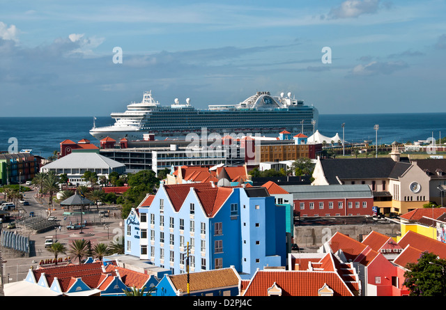 Above view of Otrobanda side of Willemstad, Curacao showing Dutch architecture and cruise ship at dock - Stock Image