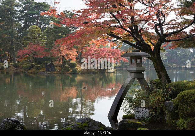 Kenrokuen Garden with Kotojitoro lantern in autumn, Kanazawa, Ishikawa Prefecture, Central Honshu, Japan, Asia - Stock Image