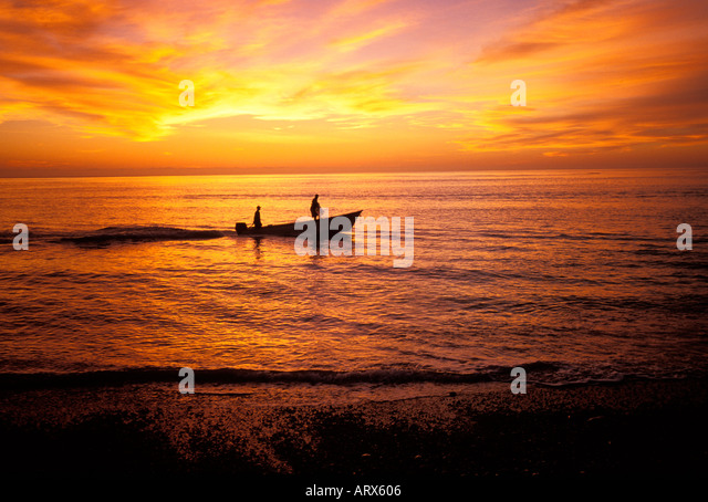 Fisherman heading out for a day of fishing at sunrise, Sea of Cortes, Cabo Pulmo, Mexico - Stock Image