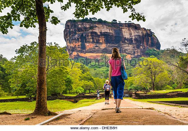 Tourist at Sigiriya Rock Fortress (Lion Rock), UNESCO World Heritage Site, Sigiriya, Cultural Triangle, Sri Lanka, - Stock-Bilder