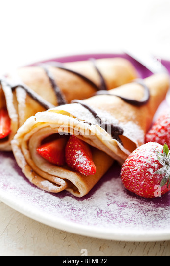 crepes with strawberries and chocolate - Stock Image