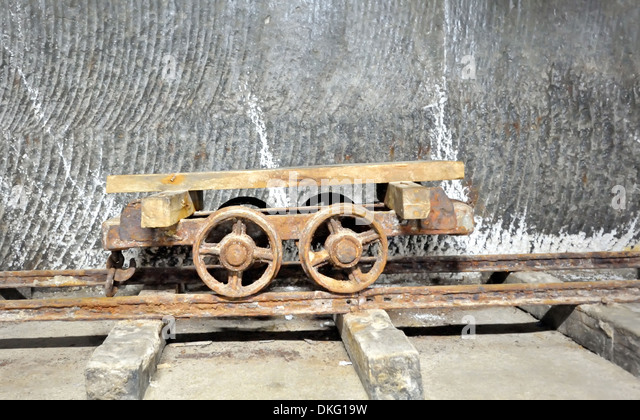 old wagon inside of salt mine on rail - Stock-Bilder