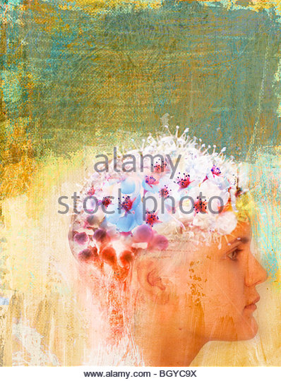 Woman with flowers on head - Stock Image