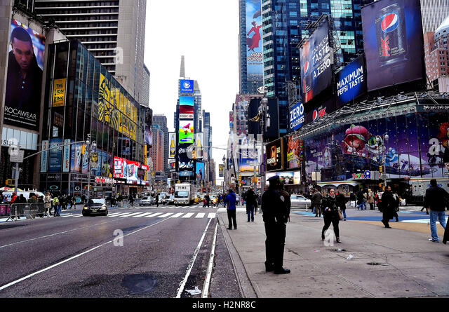 Times Square - in the Midtown Manhattan section of New York City at the junction of Broadway and Seventh Avenue. - Stock Image