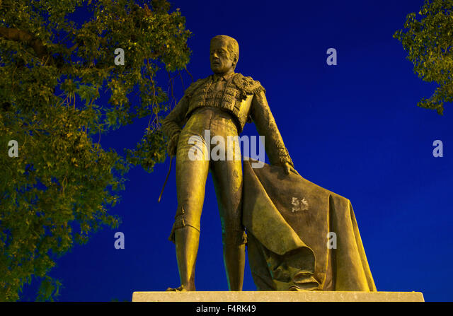 Andalusia, Spain, Europe, outside, evening, mood, atmospheric, dusk, twilight, dusk, toreador, statue, sculpture, - Stock Image