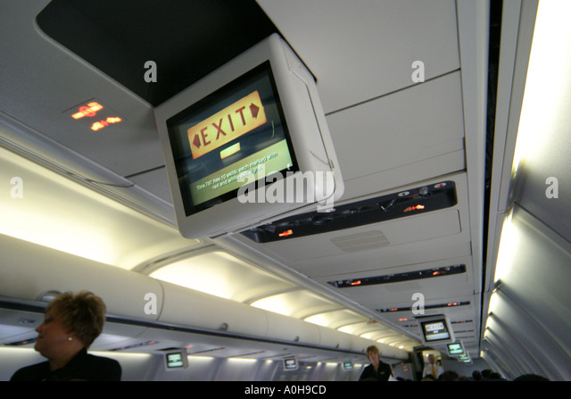 Cleveland Ohio Airport Continental Airlines safety instructions monitors - Stock Image