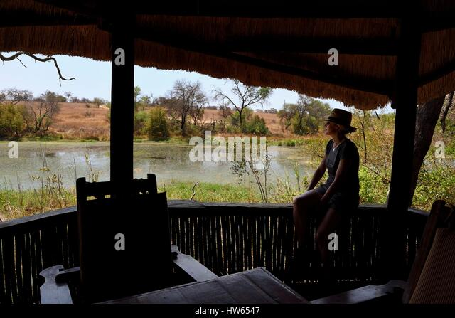 Zimbabwe, Midlands Province, Gweru, Antelope Park, terrace of a bungalow overlooking the pond - Stock Image