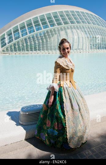 Female in traditional Falla dress at the Science park L'Hemisfèric  Fallas de Valencia - Stock Image
