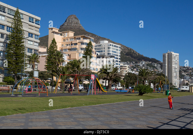 South Africa, Cape Town. Children's Playground on the Sea Point Promenade. Lion's Head in the background. - Stock Image