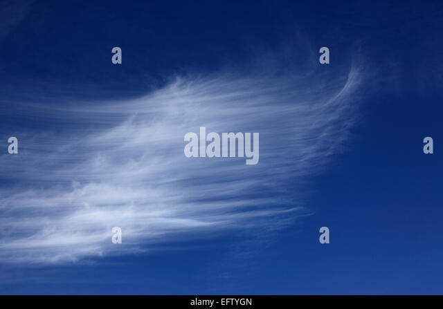 white cirrus clouds in blue sky. Photo by Willy Matheisl - Stock Image