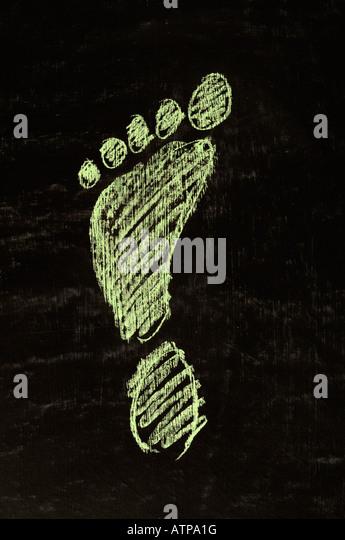 green footprint on a chalk board - Stock Image