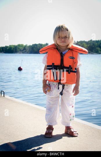 Girl in life jacket - Stock Image