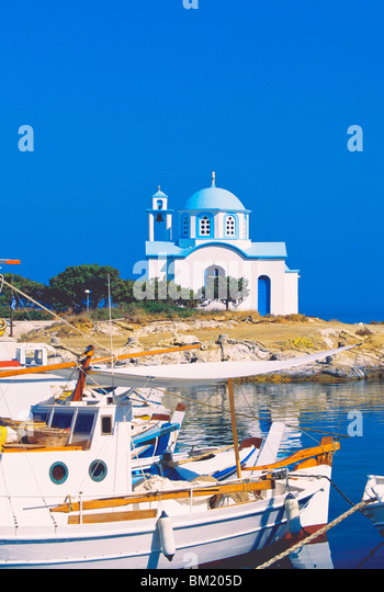 Fishing boats with a chapel in background, Chios Island, Greek Islands, Greece, Europe - Stock Image