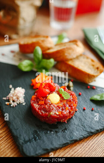 Gourmet appetizer on slate with bread - Stock Image