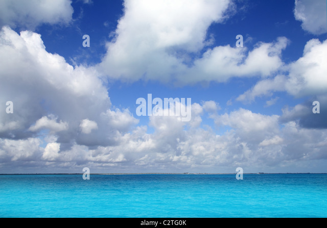 Caribbean sea horizon on blue sky cumulus vacation day perfect paradise - Stock Image