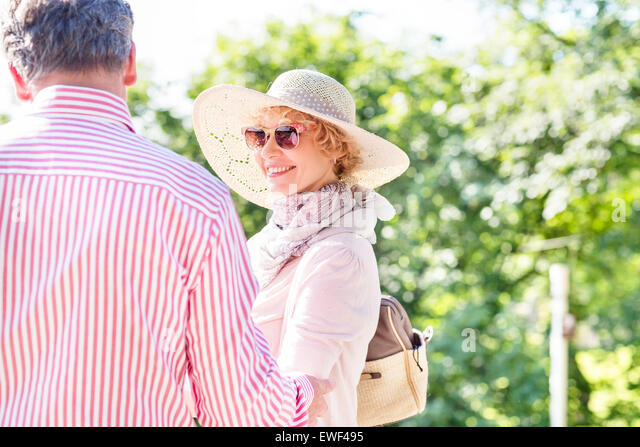 Happy middle-aged woman with man in park - Stock Image
