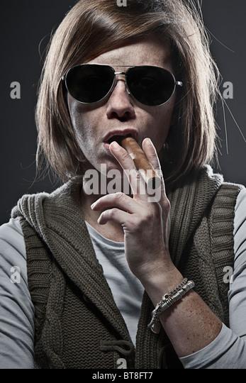 Shot of a Woman Smoking a Cigar - Stock-Bilder