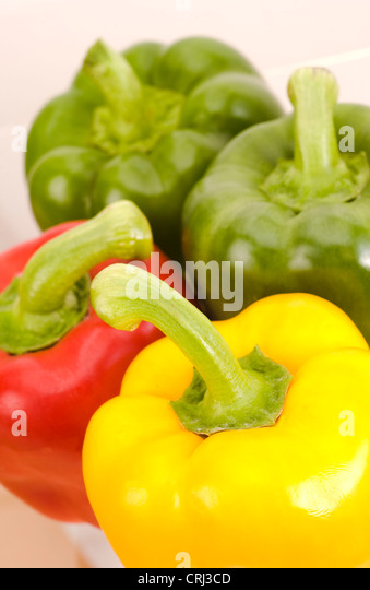 Peppers. Peppers contain vitamin C and vary in colour, due to their maturity. This colour varies through green to - Stock-Bilder