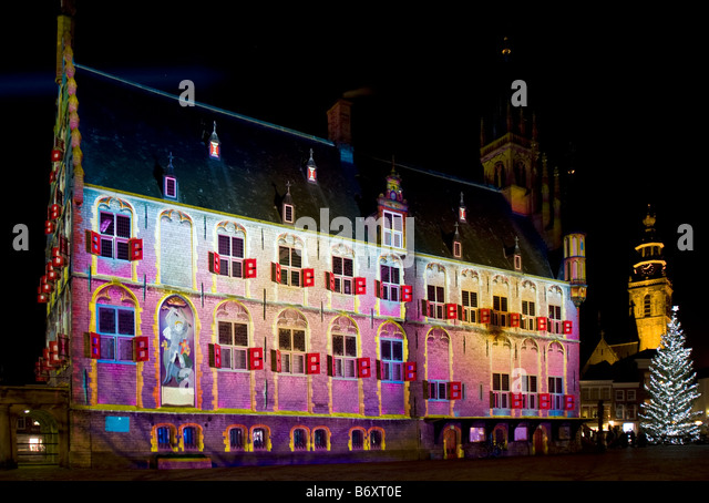 Town hall in Polychromatic Light Projection by French Artist Patrice Warrener. Market Square, Gouda, The Netherlands - Stock Image