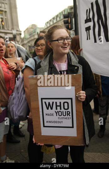 London, UK. 24th April 2014. A group of protesters carrying a banner with the words 'Inside Out' chant 'Who - Stock Image