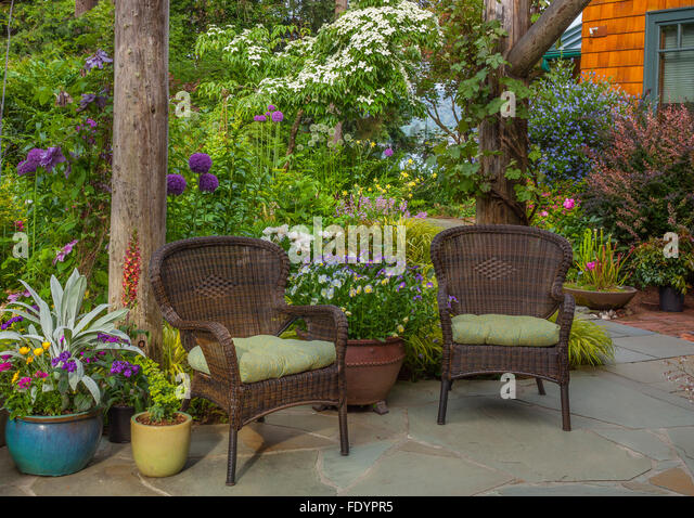 garden seating. Vashon-Maury Island, WA Outdoor Seating Area With Wicker Chairs, Colorful Pots And Garden