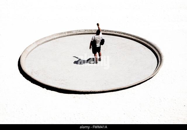 High Angle View Of Man Standing On Sun Dial - Stock Image