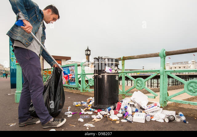 Brighton, UK. 17th June, 2013. Monday morning clean up - Brighton Pier workers clean up the mess as the city's - Stock Image