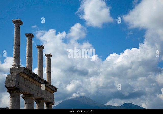 Architectural ruins of Pompeii, Italy rise-up in the shadows of Mount Vesuvius. - Stock Image