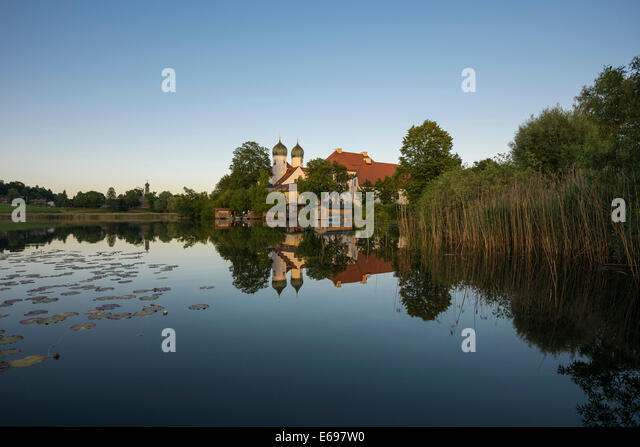 Evening mood, Seeon Abbey in Seeoner See lake, Seeon-Seebruck, Chiemgau, Upper Bavaria, Bavaria, Germany - Stock Image