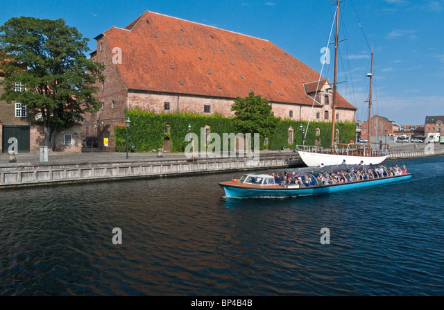 Copenhagen cruise vessel passes by the Tøjhusmuseet in Frederiksholm Kanal Copenhagen Harbour - Stock Image