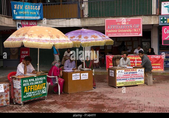 India, Jammu & Kashmir, Srinagar, Hazratbal, stalls assisting with University of Kashmir paperwork - Stock Image