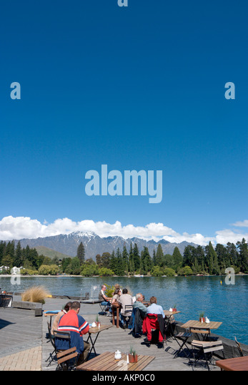 Lakeside Cafe Bar with the Remarkables behind,  Lake Wakatipu, Queenstown, South Island, New Zealand - Stock Image