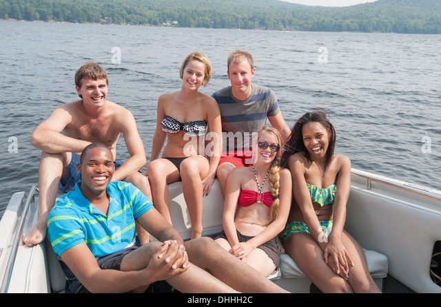 Portrait of friends in boat on vacation - Stock-Bilder