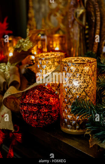 Christmas candles and decorations on a display shelf. - Stock Image