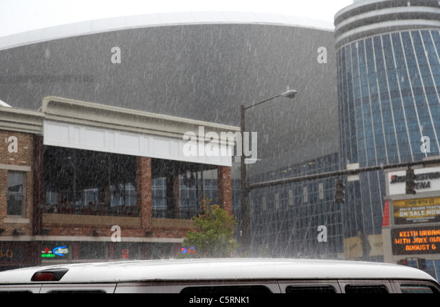 heavy rain bouncing off minivan roof in downtown broadway Nashville Tennessee USA - Stock Image