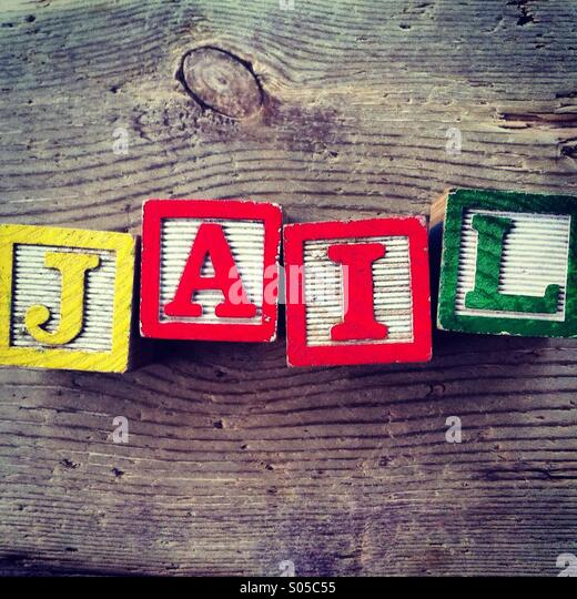 It's a photo of wood blocks toy with letters that form the word JAIL - Stock Image