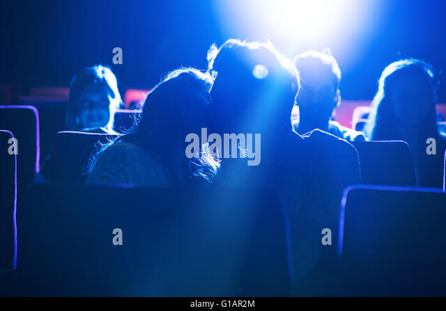 Romantic loving couple kissing at the cinema, love and relationships concept - Stock-Bilder