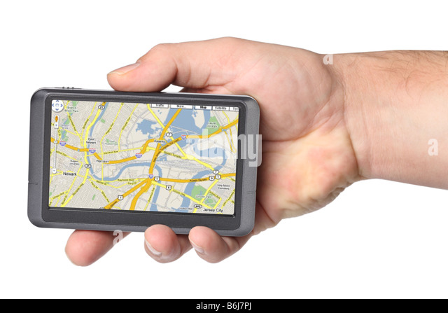 Portable GPS device in hand cutout on white background - Stock Image