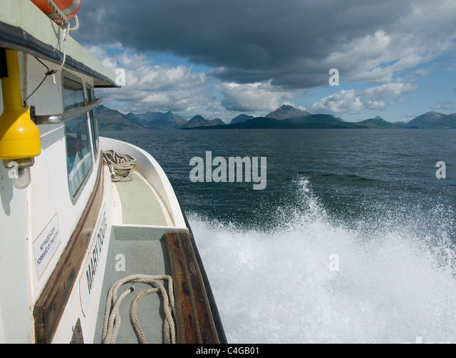 Sea spray on a boat approaching the Isle of Skye - Stock Image