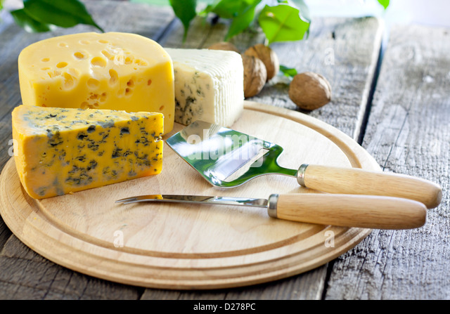 Cheese various assortment on wooden boards still life - Stock Image
