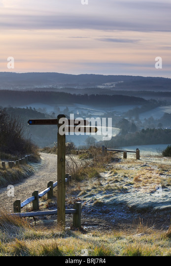 A North Downs Way sign at Newlands Corner on a frosty and misty morning at Christmas - Stock Image