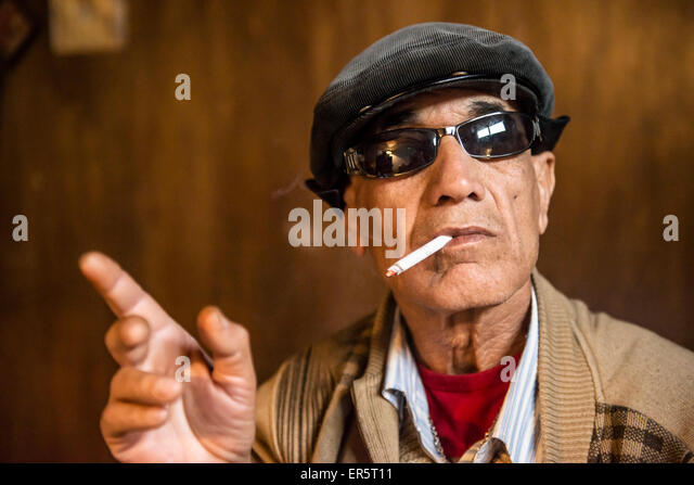 Man wearing sunglasses and smoking a cigarette, Amman, Jordan, Middle East - Stock Image
