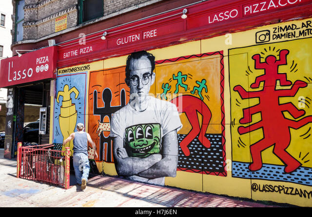 Lower Manhattan New York City NYC NY L'asso Pizza restaurant pizzeria exterior mural Keith Haring tribute street - Stock Image